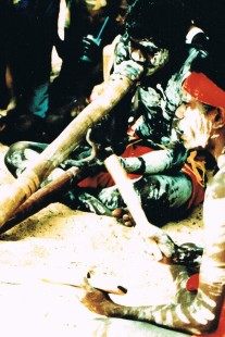 Aboriginals playing didjeridu & clapping sticks